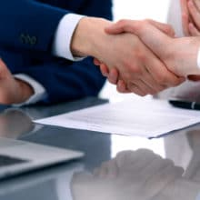 Business people shaking hands finishing up a meeting.